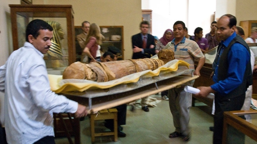 March 10, 2013: A a group of cardiologists lead by Saint Luke's Mid America Heart Institute in Kansas City, USA, show the mummy Hatiay (New Kingdom, 18th Dynasty, 1550 to 1295 BCE) as it is returned to its display back in the Antiquities Museaum in Cairo after it underwent a CT scanning.