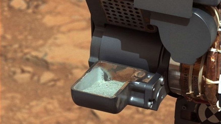 NASA's Curiosity rover shows the first sample of powdered rock extracted by the rover's drill. The picture was taken on Feb. 20, or Sol 193, Curiosity's 193rd Martian day of operations.