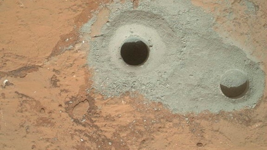 "The hole in a rock called ""John Klein"" where NASA's Mars rover conducted its first sample drilling on Mars on Feb. 8, 2013, or Sol 182, Curiosity's 182nd day on Mars."