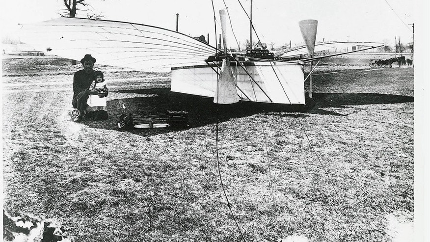 "Aviation Pioneer Whitehead with daughter Rose in front of his ""No. 21"". In the foreground is his self-built gas pressure motor."