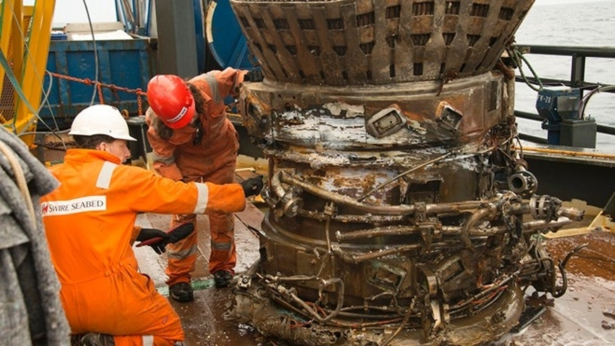 March 19, 2013: Workers inspect a thrust chamber of an Apollo F-1 engine recovered from the bottom of the Atlantic Ocean by Amazon CEO Jeff Bezos.
