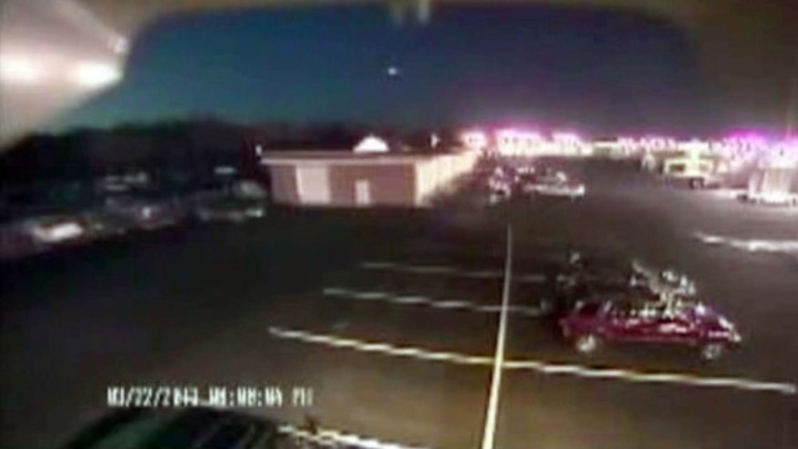 March 22, 2013: A bright flash of light, top center, streaks across the early-evening sky in what experts say was almost certainly a meteor coming down in Seaford, Del.