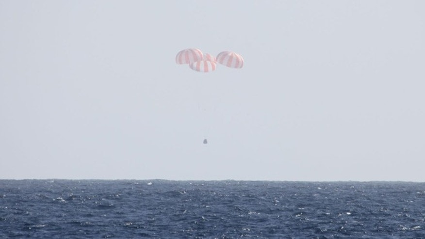 SpaceX's Dragon capsule uses parachutes to descend to the Pacific Ocean off the coast of Mexico's Baja Peninsula after leaving the International Space Station.