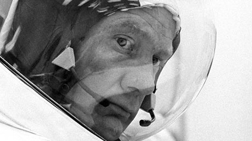 Astronaut Buzz Aldrin suits up for a countdown demonstration test prior to the launch of Apollo 11 on July 5, 1969.