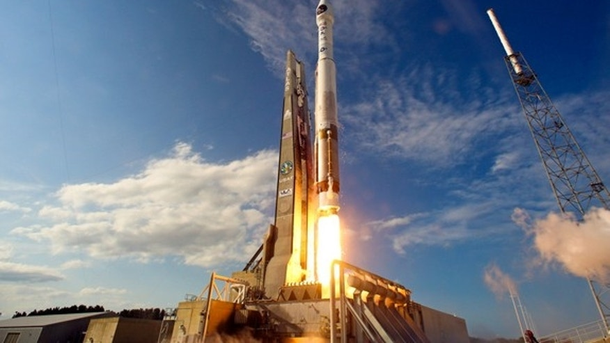 A United Launch Alliance Atlas 5 rocket blasts off from Space Launch Complex-41 at Cape Canaveral Air Force Station carrying the second Space-Based Infrared System (SBIRS) GEO-2 satellite for the U.S. Air Force at 5:21 p.m. EDT on March 19, 201