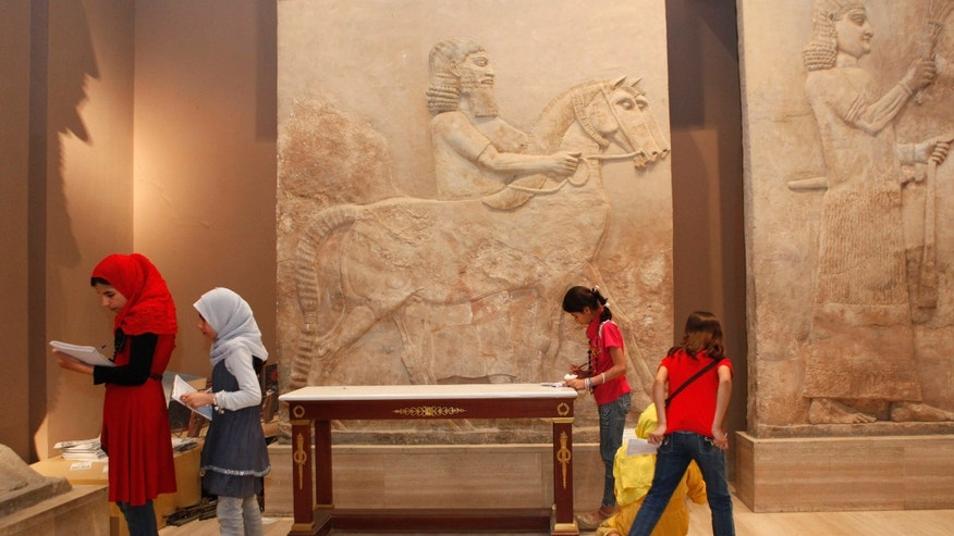April 2, 2013: School students visit the restored Iraqi National Museum in Baghdad, Iraq. Ten years after Iraq's national museum was looted and smashed by frenzied thieves during the U.S.-led invasion in 2003 to topple Saddam Hussein, it's still far from ready for a public re-opening.