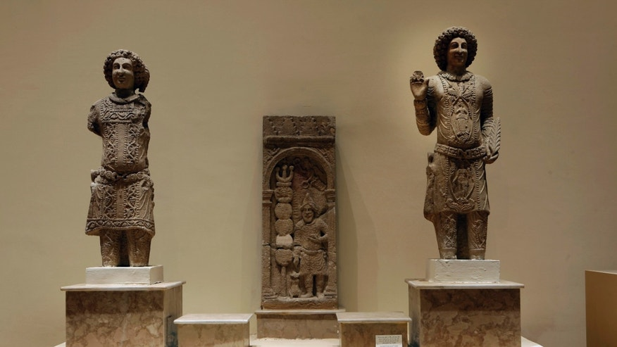 April 3, 2013: Stone figures depicting the family of Sanatruq the 1st, found at Hatra, are displayed at the Iraqi National Museum in Baghdad, Iraq.