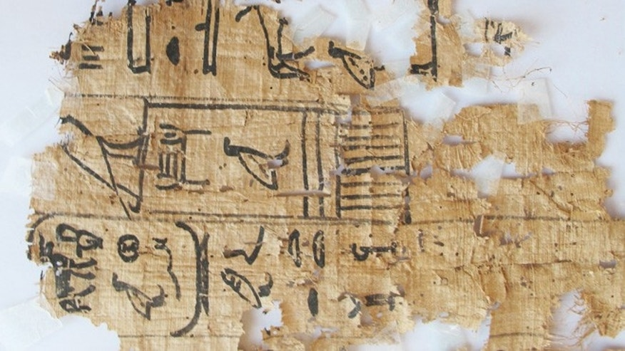 April 11, 2013: A hieroglyphic papyrus discovered at Wadi el-Jarf, nearly 111 miles south the coastal city of Suez, Egypt. Egypts state of antiquities affairs minister has declared the discovery of a historic coastal port dating back to King Khufu of the fourth dynasty of the old pharaonic kingdom, as well as this hieroglyphic papyri and stone anchors. Most of the discovered papyri date back to the 27th year of the reign of King Khufu. The papyri included information about number of the port workers and details about their daily lives. They were transferred to the Suez museum for study and registration.