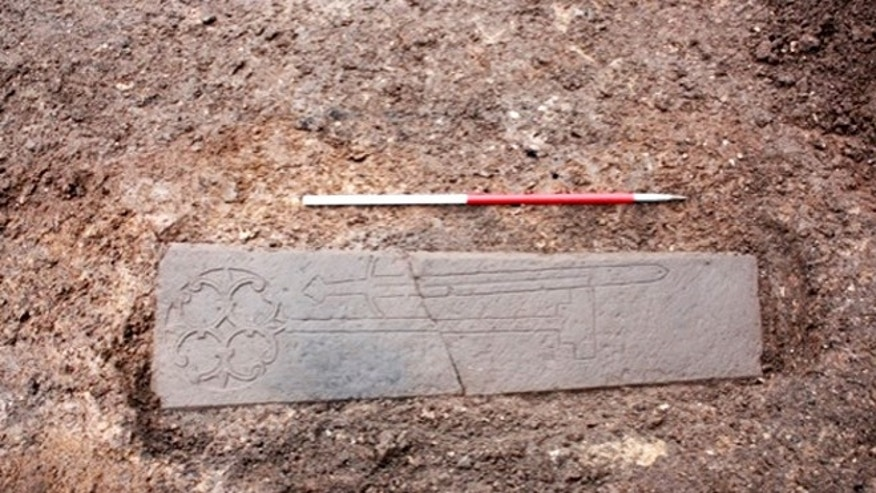 This carved slab, thought to be the headstone of a medieval knight, was found under a parking lot in Edinburgh. Now researchers say they have unearthed what may be the knight's family.