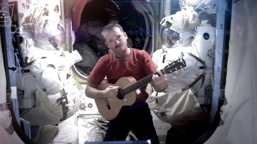 This image provided by NASA shows astronaut Chris Hadfield recording the first music video from space.