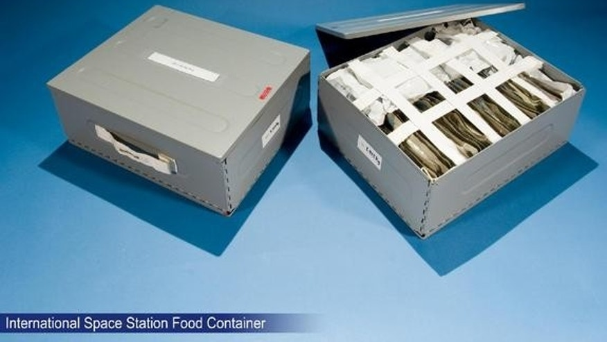 Food container for use aboard the International Space Station. Food not only provides nutrition for astronauts, but also enhances the psychological well-being of the crew by establishing a familiar element in an unfamiliar and hostile environme