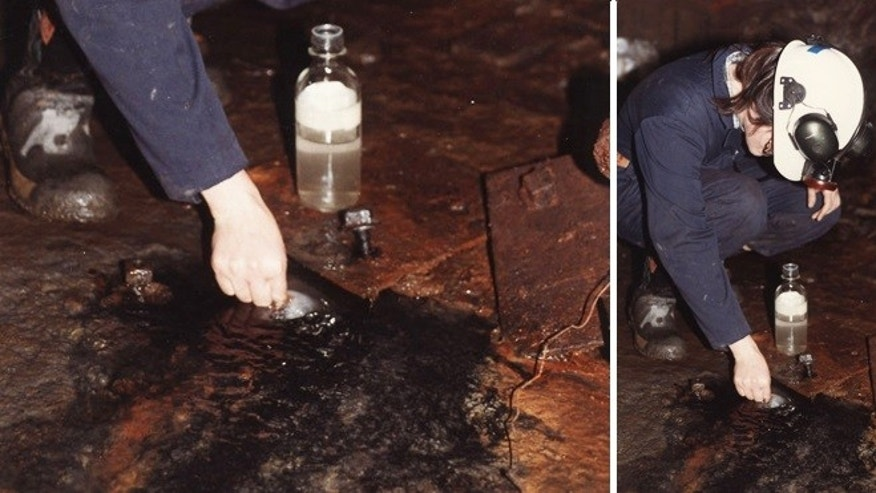 A scientist takes a sample of water from a mine deep underground in Ontario, Canada. The water turned out to be 2.6 billion years old, the oldest known water on Earth.