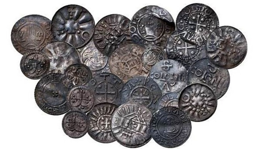 Coins from  Bohemia, Germany, Denmark and England discovered during an archaeological dig last year, some of 365 items from the Viking era. Danish National Museum spokesman Jens Christian Moesgaard says the coins have a distinctive cross motif attributed to Norse King Harald Bluetooth, who is believed to have brought Christianity to Norway and Denmark.