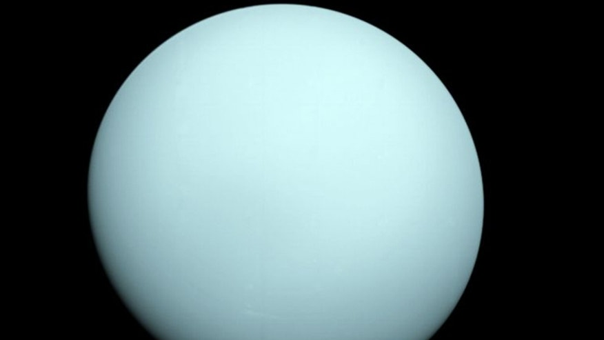 Shrouded in a dense layer of clouds, Uranus appears as an almost featureless world when viewed in visible light.