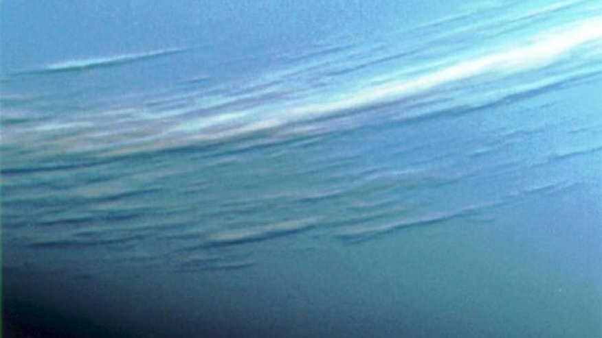 The Voyager 2 spacecraft photographed bands of clouds around Neptune during its flyby in 1989.