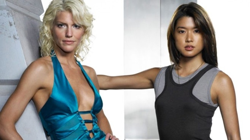"Actresses Tricia Helfer (left) and Grace Park (right), who played humanoid Cylons with countless clones on the TV show ""Battlestar Galactica."""