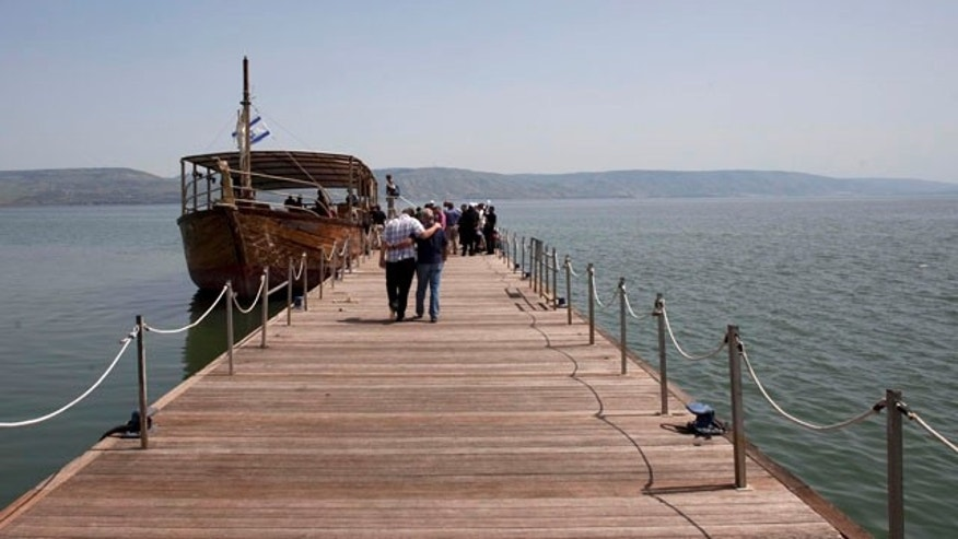 A boat is by the jetty of the Capernaum National Park in the Sea of Galilee in northern Israel.