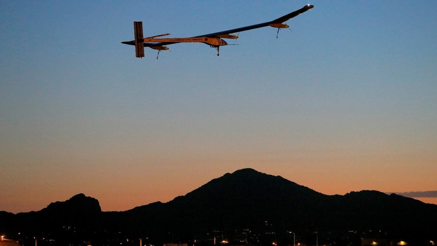 Solar Impulse, piloted by André Borschberg, takes flight during the second leg of the 2013 Across America mission, at dawn, Wednesday, May 22, 2013, from Sky Harbor International Airport in Phoenix. The solar powered aircraft is scheduled to land at Dallas/Fort Worth International Airport on Thursday May 23. The plane's creators, Bertrand Piccard and Borschberg, said the trip is the first attempt by a solar airplane capable of flying day and night without fuel to fly across America. (AP Photo/Matt York)
