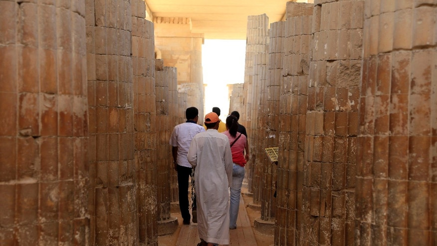 May 30, 2013: Tourists visit the Step Pyramid of King Djoser, the oldest of more than 100 pyramids in Egypt, built in the 27th century B.C., at the Saqqara archaeological site, 19 miles south of Cairo, Egypt.