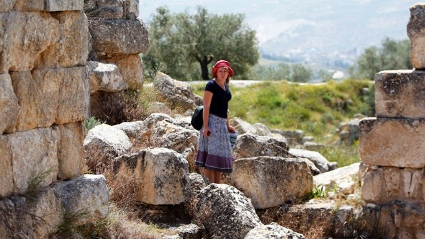 April 6, 2013: An Italian tourist visits the Roman Temple of Augustus in the village of Sebastia near the West Bank city of Nablus. The ancient town of Sebastia is one of the greatest archaeological sites of the Holy Land, attracting tourists and pilgrims over the centuries with its overlapping layers of history dating back 3,000 years. But visitors who come to the site today will find it in a state of neglect.