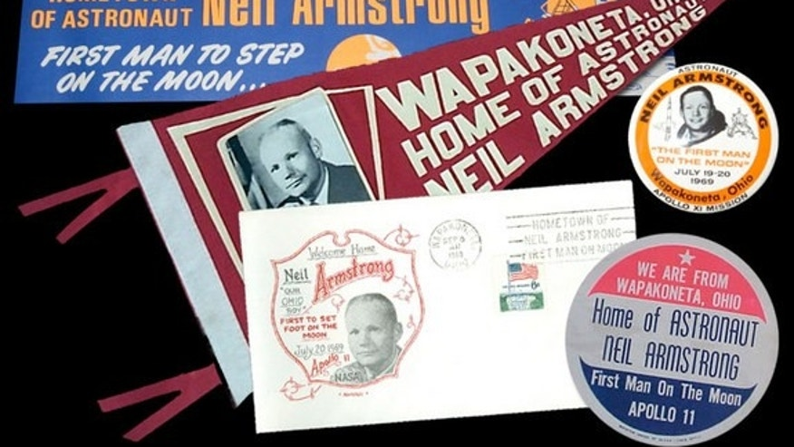 Vintage memorabilia celebrating Neil Armstrong's connection to Ohio and his hometown of Wapakoneta. The first moonwalker's Ohio accent may have led to his famous first words on the moon being misheard.
