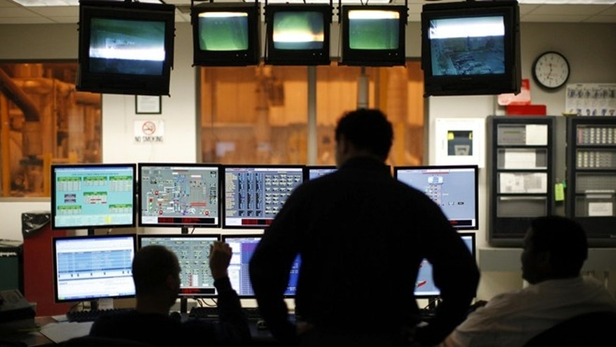 Engineers in a control room in Union, N.J., oversee the waste-to-energy conversion process on computer monitors.