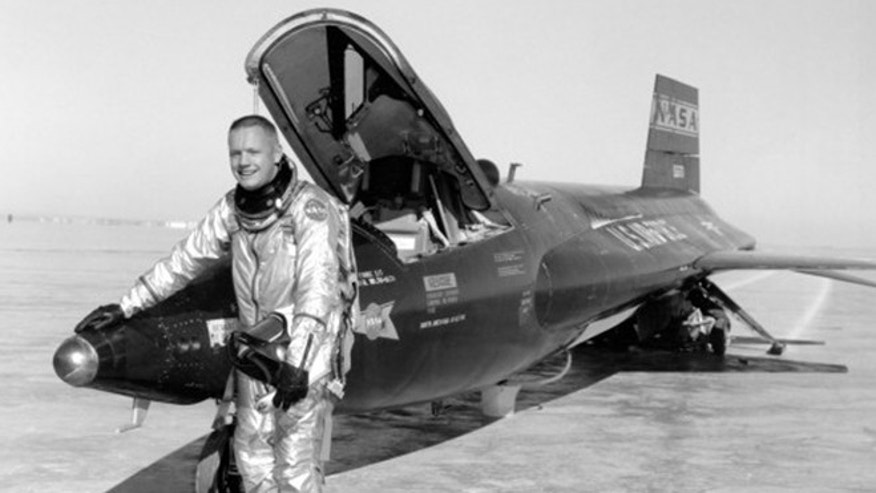 This 1960 image provided by NASA shows Neil Armstrong standing by an X-15 rocketplane after a test flight. Armstrong later went on to become the first man to walk on the moon. A bill in Congress wants to rename the  NASA Dryden Flight Research Center in Southern California after the Apollo 11 astronaut to honor his time there as a test pilot.
