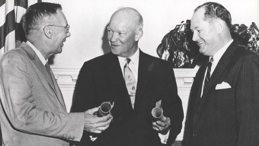 President Dwight Eisenhower, center, commissioning Dr. T. Keith Glennan, right, as the first administrator for NASA and Dr. Hugh L. Dryden as deputy administrator, in Washington, D.C. A bill in Congress wants to rename the NASA Dryden Flight Research Center in Southern California after Neil Armstrong, the Apollo 11 astronaut to honor his time there as a test pilot.