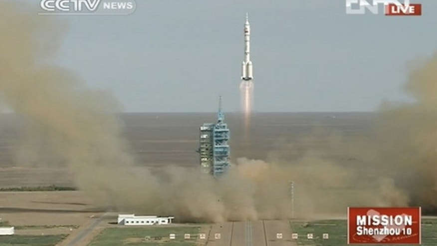 Three Chinese astronauts blasted into space June 11, 2013 on the nation's fifth manned space mission.