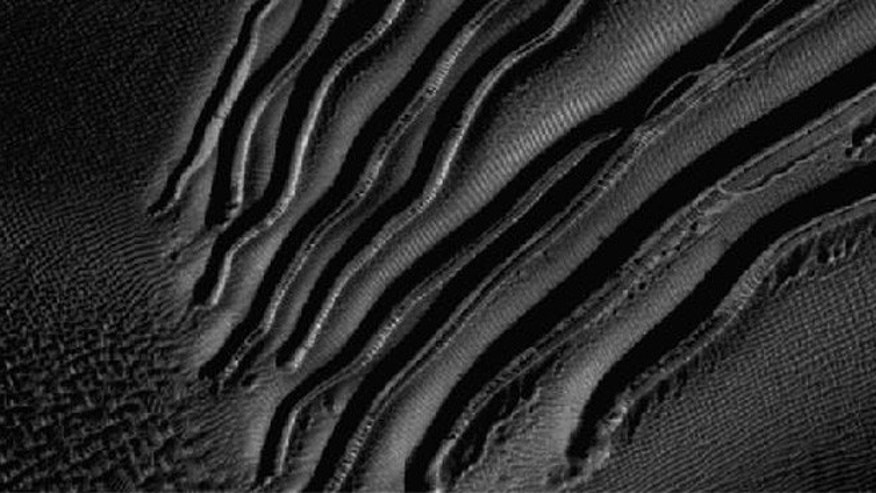 "This image from a camera on NASA's Mars Reconnaissance Orbiter is an example of a type called ""linear gullies."""