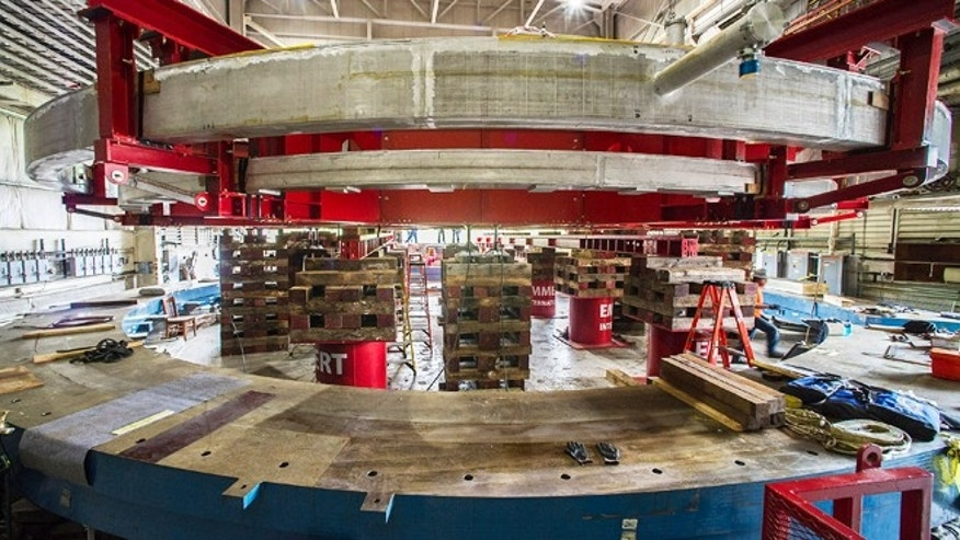 June 11, 2013: A 50-foot-wide electromagnet storage ring, at Brookhaven National Laboratory in Upton, N.Y., on eastern Long Island. The ring, which will capture subatomic particles that live only 2.2 millionths of a second, will be transported in one piece, and moved flat, to its new home at the U.S. Department of Energy's Fermi National Accelerator Laboratory in Batavia, Ill.
