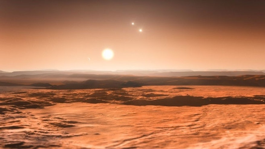 This artists impression shows the view from the exoplanet Gliese 667Cd looking towards the planets parent star (Gliese 667C). In the background to the right the more distant stars in this triple system (Gliese 667A and Gliese 667B) are visible and to the left in the sky one of the other planets, the newly discovered Gliese 667Ce, can be seen as a crescent.