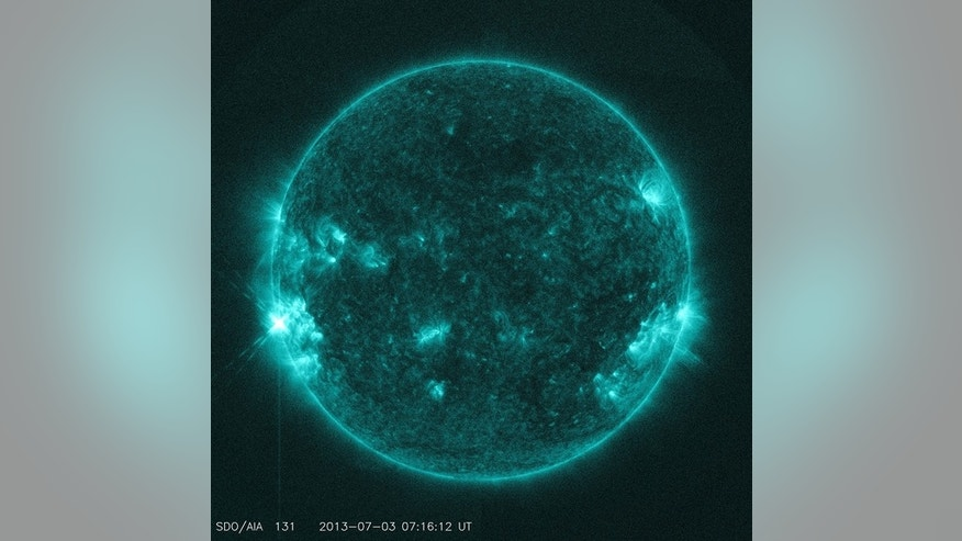 The sun unleashed an M1.5-class solar flare (lower left) on July 3, 2013, a solar fireworks to the traditional Fourth of July holiday in the United States.