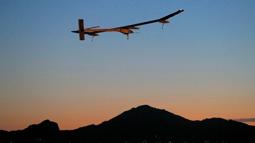 This May 22, 2013 file photo shows the Solar Impulse, piloted by André Borschberg, taking flight, at dawn, from Sky Harbor International Airport in Phoenix. The plane started its cross-country journey May 3 from San Francisco.