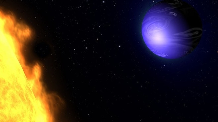 "This illustration shows a ""hot Jupiter"" planet known as HD 189733b orbiting its star, HD 189733. The NASA/ESA Hubble Space Telescope measured the actual visible light colour of the planet, which is deep blue. This color is not due to the presence of oceans, but is caused by the effects of a scorching atmosphere where silicate particles melt to make ""raindrops"" of glass that scatter blue light more than red light."