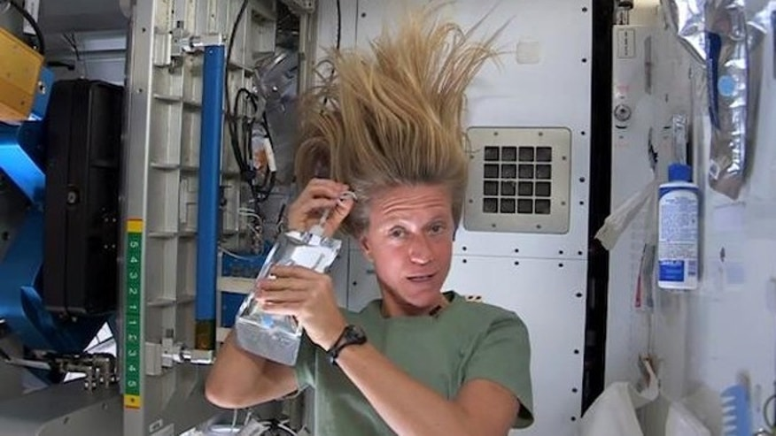 astronaut washing her hair in space - photo #5