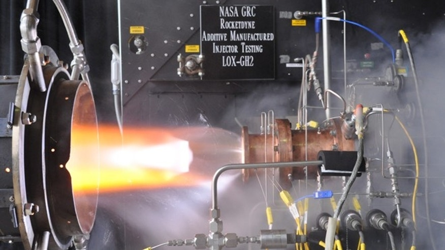 Liquid oxygen/gaseous hydrogen rocket injector assembly built using additive manufacturing technology is hot-fire tested at NASA Glenn Research Centers Rocket Combustion Laboratory in Cleveland.