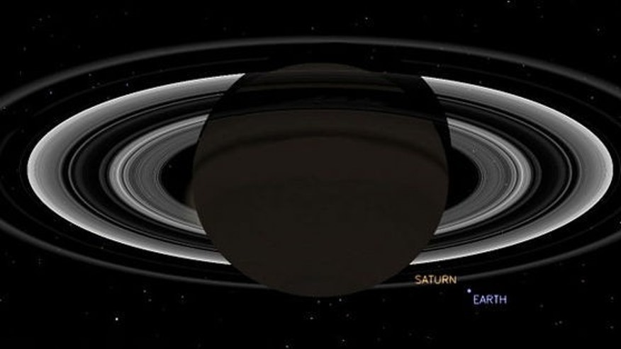 This simulated view from NASA's Cassini spacecraft shows the expected positions of Saturn and Earth on July 19, 2013, around the time Cassini will take Earth's picture. Cassini will be about 898 million miles (1.44 billion kilometers) away from