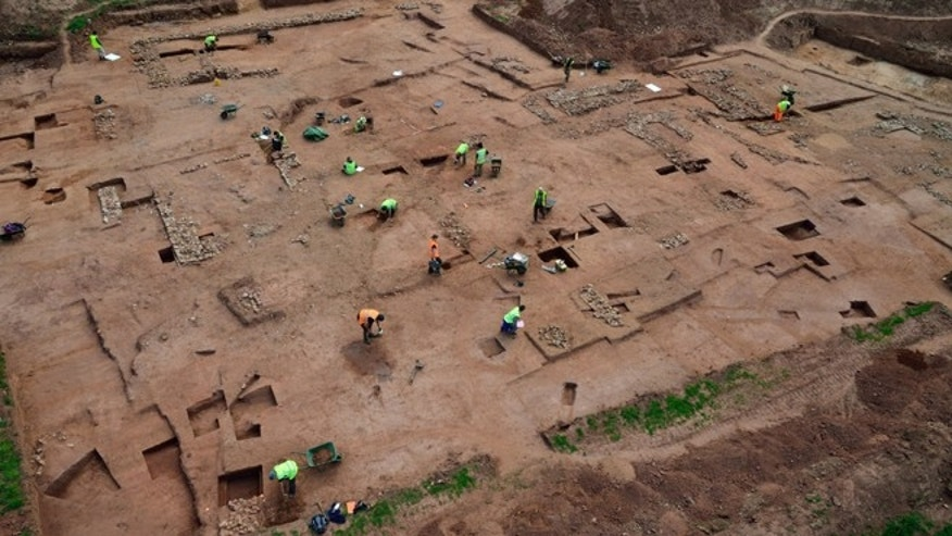 British archaeologists have uncovered the remains of stone foundations in a pattern which suggests that there may have been a series of medieval buildings on a modern construction site. The mystery lies in exactly what the buildings were once used for.