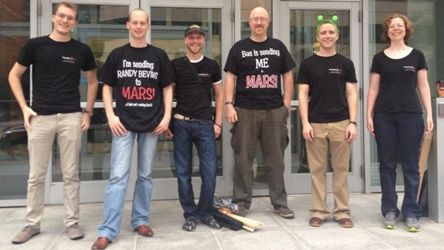 "Joseph Sweeney, Bas Lansdorp (Mars One founder), Aaron Hamm, Randy Bevins, Austin Bradley and Heidi Hech pose for a photo before the first ""Million Martian Meeting"" -- a gathering of potential colonists to the Red Planet."