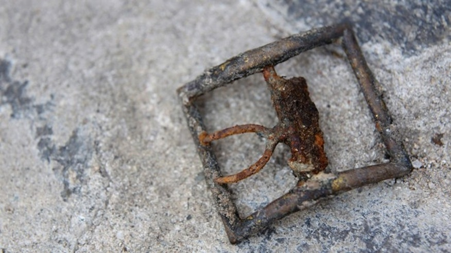 Aug. 7, 2013: A belt buckle is on display during a news conference in New York, one remnant of early New York life workers discovered just steps from Wall Street while digging under Manhattan to install new utilities.