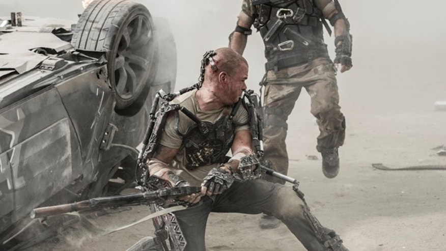 "Max (Matt Damon, left) and Kruger (Sharlto Copley) battle it out in TriStar Pictures' ""Elysium."""