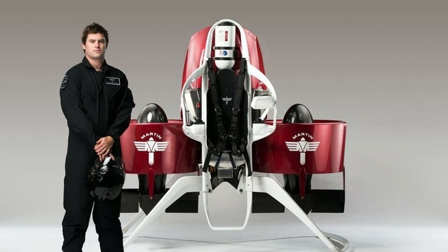 A model stands next to a newly developed personalised jetpack in Christchurch, New Zealand, pictured August, 2013. Authorities have issued a permit allowing manned test flights of the gadget.