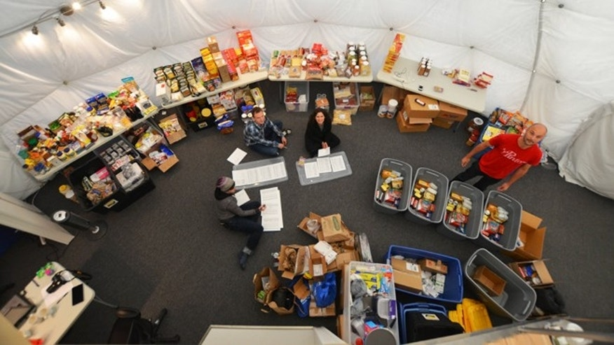 April 17, 2013: Researchers studying what meals astronauts might eat on a mission to Mars organize food inside a simulated Martian base dome on Mauna Loa, Hawaii.