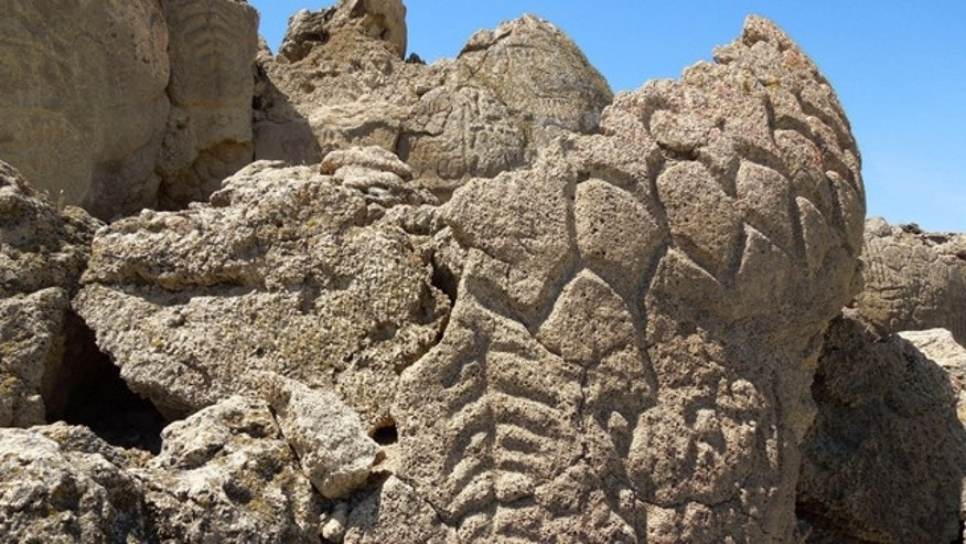 Ancient carvings on limestone boulders in northern Nevada's high desert near Pyramid Lake.