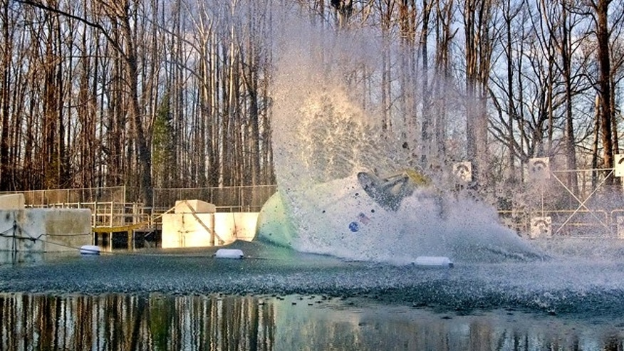 Dec. 13, 2011: An 18,000-pound test version of the Orion space capsule took its eighth and final splash of the year into the Hydro Impact Basin at NASA Langley Research Center.