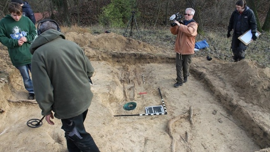 The grave of a medieval Slavic warlord, with a bronze bowl at his feet, was uncovered in Germany by a digging badger.