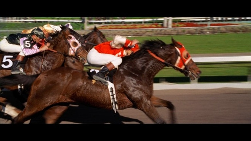 "A frame from the film ""Seabiscuit,"" which tells the tale of the legendary racehorse."