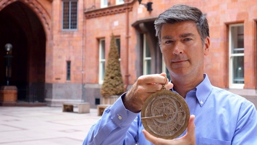 Aug. 14, 2013: Art Loss Register director Chris Marinello shows a rare 16th-century scientific artifact that has been missing from a Swedish museum for a decade, in London.
