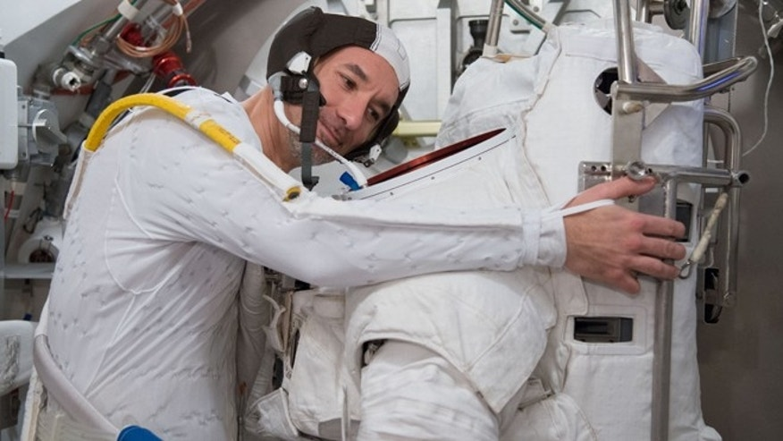 Astronaut Luca Parmitano, who nearly drowned during a spacewalk in July 2013,  participates in a spacesuit fit check in the Space Station Airlock Test Article (SSATA) of the Crew Systems Laboratory at NASA's Johnson Space Center in Houston.